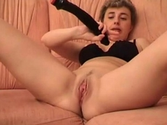 Short haired blonde wife fucking her pink pussy with huge black vibrator