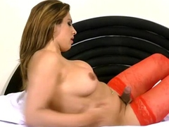Inviting shemale redhead licks her boobs while tugging off