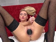 Horny pamper in stockings orgasms with a magic wand